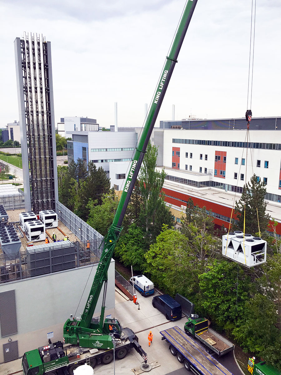 The final chiller is craned into position on the roof top of the hospital's energy centre.